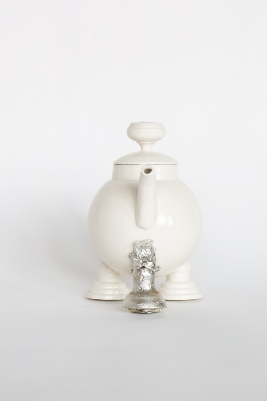 Teapot with pewter front leg, 2021. Porcelain and pewter